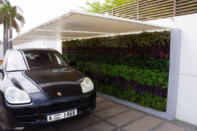 A Biotecture outdoor wall with shade canopy
